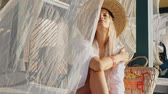 strohhut : Gorgeous blonde woman 20s in summer straw hat have a rest on the beach Stock Footage