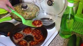 вкусный : A woman is preparing cutlets from salmon meat. Стоковые видеозаписи