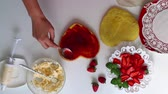 fırın : The process of making a biscuit with cream and strawberries. Stok Video