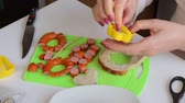 codorna : Breakfast of sausages, quail eggs, herbs and vegetables. Ingredients are on the table Stock Footage
