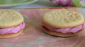 biscoitos : Cooked marshmallow sandwiches. They lie on food paper. View from above. Stock Footage