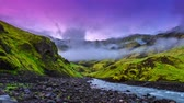 laugavegur : 4K TimeLapse. Valley Thorsmork - Hundreds of streams of water from the glaciers flow down the mountains, into the cloud layer and were shrouded by an eerie fog. Iceland, June 15, 2015 Stock Footage