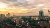 skyline : Aerial view Dawn in the city of Bandung. 4K Timelapse - Bandung, West Java, Indonesia, June 2016. Stock Footage