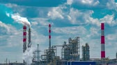 oil factory : Refinery tower in petrochemical industrial plant with cloudy sky Stock Footage