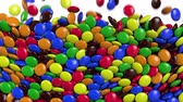 Round colored candies are falling. Alpha channel. 3D rendering