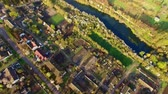 aerial view of beautiful streets, houses and colorful gardens Stock mozgókép