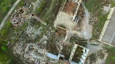 Aerial view of a destroyed factory. Remains of buildings. Stock mozgókép