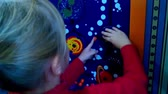 рычаг : Lovely little girl playing with big toys construction. Blonde girl plays in a large indoor childrens toy. Screen for the video clip. Стоковые видеозаписи