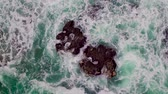 turkus : Aerial view of rocky coastline with crashing waves.