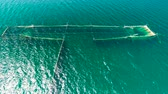 netting : Fishing Nets in the sea water near the coast of the Black Sea in Varna, Bulgaria, aerial drone view.