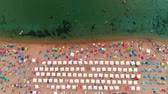 şemsiye : Aerial top view on the beach. Umbrellas, people, sand and sea waves Stok Video