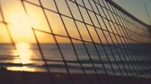 beach ball : Volleyball net and beautiful sunrise on the sandy tropical beach Stock Footage