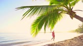 Багамские острова : Woman running on tropical exotic beach. Summer  holiday. Стоковые видеозаписи