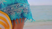 küba : Girl with hat relaxing on tropical beach. Summer vacation in Dominican Republic and Caribbean islands. Stok Video