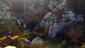 日の出 : Aerial drone view of beautiful waterfall and autumn forest in Plitvice National Park, Croatia