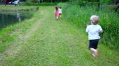 Children running in nature on a sunny day (Package of 2 scenes, traveling with two girls running, tracking their children