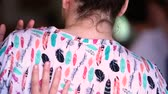 mobilize : Dance festival workshop. Close up of woman in white shirt with feather pattern receiving a shoulder massage from back view with selective focus Stock Footage