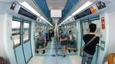 életmód : DUBAI, UAE - FEBRUARY, 2017: the interior of a moving subway car with people in Dubai, UAE.