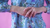 delicadeza : beautiful female hands on a background blue shirt