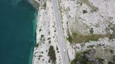 Aerial view of Croatia, winding roads and crystal clear sea. Coast of the island of Pag Stock Footage