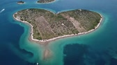 evlenmek : Island of lovers, Otok Galesnnjak, islet, rock. Also called otok za Zaljubljene, island of love. Municipality of Torrette Stok Video