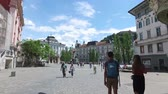 Central streets of the city of Ljubljana the capital and largest city of Slovenia. 06262018. People strolling in the pedestrian area of the city. Churches and castle on the hill.