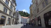 Central streets of the city of Ljubljana the capital and largest city of Slovenia. 06262018. People strolling in the pedestrian area of the city. Churches and castle on the hill