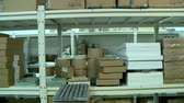 shelves with boxes in stock front pan