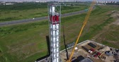 Chimney pipe construction aerial, fly back Stok Video