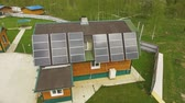加熱 : Aerial view of eco-friendly house with solar panels karelian landscape on back 動画素材