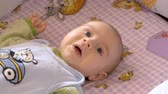tender : Little boy lying on his back and looking on the top. Stock Footage