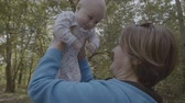 nesil : Grandmother lift up and kiss happy baby in slow motion 4k.