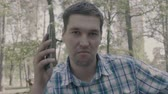 dumb : Man with ugly face say hello on the phone. 4k slow motion. Stock Footage