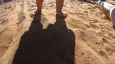 krok : Cute shadow of the little kid that walks on the beach.