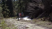 śnieżka : Three tourists talking and one throwing a snowball in the Carpathians in slo-mo