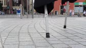 palafitte : Stilts close up of a circus performer walking in the square in slow motion