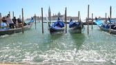 雄大な : People going to gondola on canal near San Marco in Venice