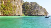 Panoramic view of famous Phi Phi island in Thailand with sea, boats and mountains in beautiful lagoon where the Beach movie was filmed. 4K clip