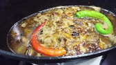 plov : Cooking of boiling traditional asian pilau with lamb meat, rice and red and green chili peppers. 4K clip