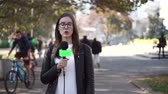 microphone : Girl journalist is reporting on the street