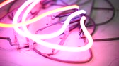 неон : colored neons in the workshop, a sign of colorful neons Стоковые видеозаписи