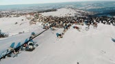space scenics : Aerial view of small village in countryside with snowy fields around in sunshine