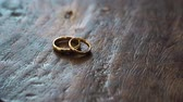 diamante : gold wedding rings on a wooden box