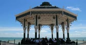 holiday : View of orchestra playing music on the victorian bandstand in Brighton and Hove