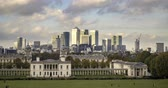 classic : Time lapse view of the Old Royal Naval College and the Queens house in Greenwich, London, with the financial district of the Docklands in the background Stock Footage