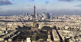 la defense : Panning aerial time lapse view of the Eiffel tower and the financial district of La Defense in Paris Stock Footage