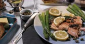 capers : Dolly view of a delicious roasted organic salmon with capers and dill