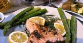 capers : Dolly close up push in view of a delicious roasted organic salmon with capers and dill