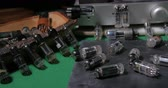 Dolly close up view of a collection of vintage vacuum tubes (valves) tor music amplifiers manufactured in the forties Stock Footage