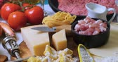 ground meat recipes : Dolly view of ingredient for bolognese sauce for lasagne, tortellini, fettuccine